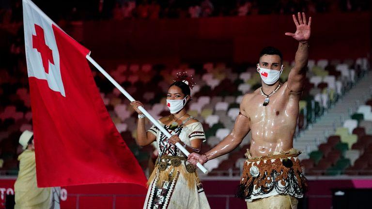 Tonga flag bearers Malia Paseka (L) and Pita Taufatofua