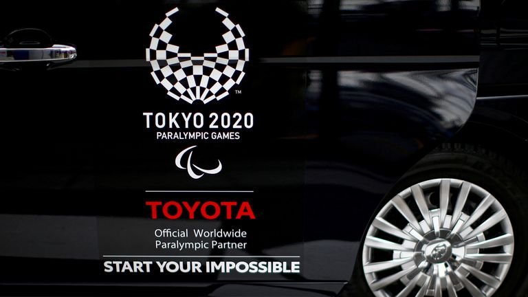 A Toyota logo, Worldwide Sponsor for Tokyo 2020 Olympic Games, is pictured on a taxi in Tokyo, Japan March 17, 2020