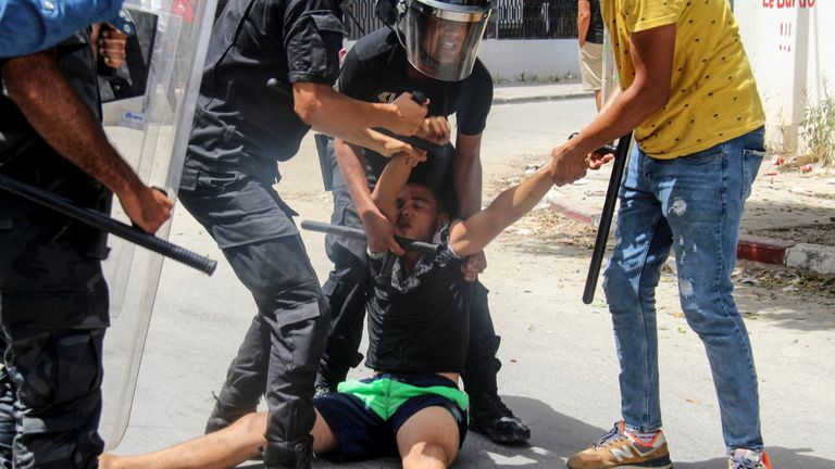 The decision to oust the prime minister was sparked by violent protests across Tunisia on Sunday. Pic AP