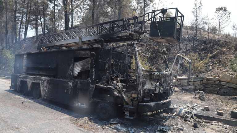 A burnt fire truck is seen in an area scorched by a forest fire near the town of Manavgat, east of the resort city of Antalya, Turkey, July 29, 2021. REUTERS/Kaan Soyturk
