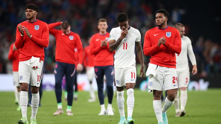 England's Tyrone Mings (left), Marcus Rashford (centre) and Reece James following defeat in the penalty shoot-out after the UEFA Euro 2020 Final at Wembley Stadium