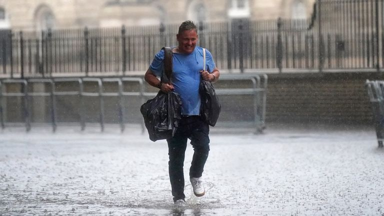 Heavy rain is falling on central London as the Met Office has issued amber warnings for the South