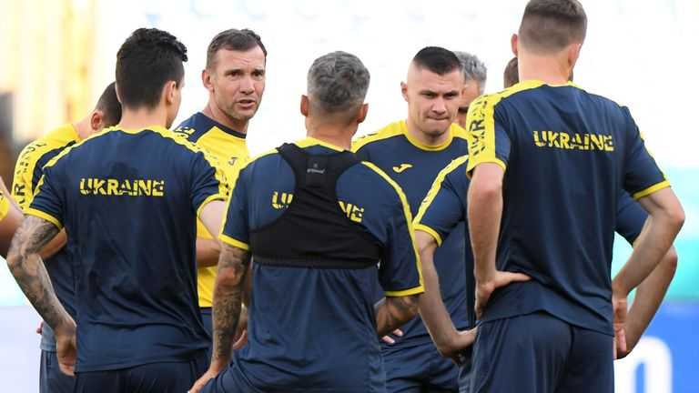 Ukraine coach Andriy Shevchenko chats with players at the Stadio Olimpico ahead of the quarter final