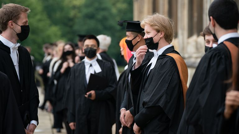 Students from King's College prepare for the procession to Senate House for their graduation ceremony at the University of Cambridge