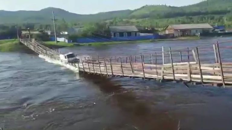 A suspension bridge collapsed as a truck tried to drive across during severe floods in eastern Russia