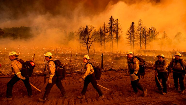 Firefighters from the California Department of Forestry and Fire Protection's Placerville station battle raging blazes