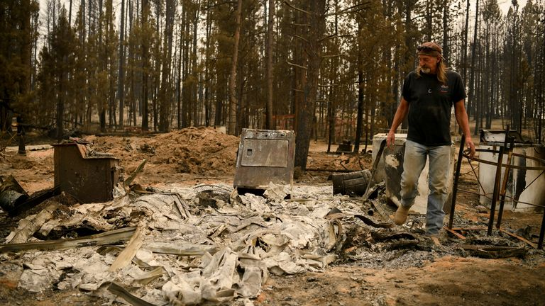 Scott Griffin surveys his property which was destroyed by the wildfires in Oregon