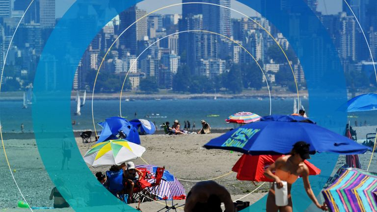 People head to the beach to cool off during the scorching heatwave in Vancouver, British Columbia