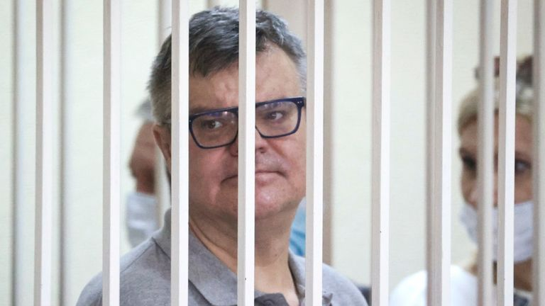 Viktor Babariko, the former head of Russia-owned Belgazprombank, stands inside a cage in a court room in Minsk, Belarus. Pic: AP