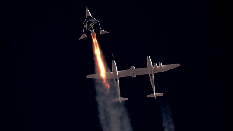 Virgin Galactic's passenger rocket plane VSS Unity, carrying Richard Branson and crew, begins its ascent to the edge of space above Spaceport America near Truth or Consequences, New Mexico, U.S. July 11, 2021 in a still image from video. Virgin Galactic/Handout