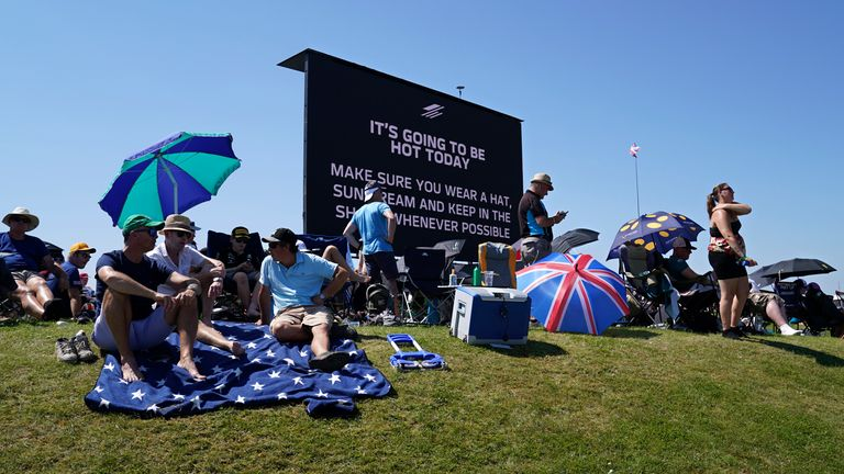 A video screen shows a hot weather warning as fans wait for the start of the British Formula One Grand Prix, at the Silverstone circuit, in Silverstone. Pic: AP