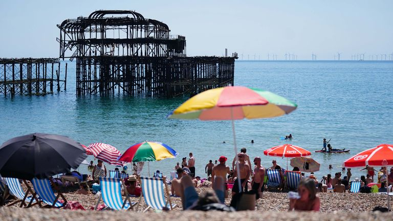 People enjoy the hot weather on Brighton beach