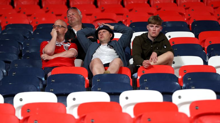 Soccer Football - Euro 2020 - Final - Italy v England - Wembley Stadium, London, Britain - July 11, 2021 England fans look dejected after the match Pool via REUTERS/Carl Recine