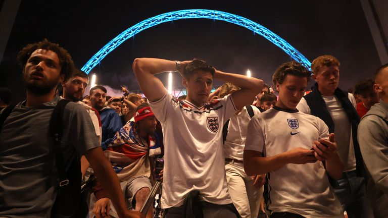 Soccer Football - Euro 2020 - Final - Fans gather for Italy v England - Wembley Stadium, London, Britain - July 11, 2021 England fans react after Italy wins the Euro 2020 outside Wembley Stadium Action Images via Reuters/Lee Smith