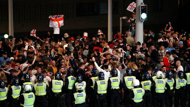 Police hold back fans outside the final at Wembley. Pic: Action Images / Reuters / Peter Cziborra