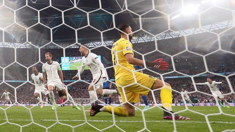 England's Luke Shaw celebrates scoring the opening goal of the Euro 2020 final against Italy