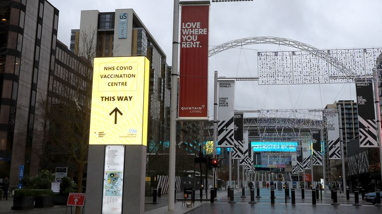 A sign pointing the way to the Wembley vaccination centre on the approach to the famous stadium