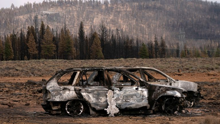 The remnants of cars destroyed by the Bootleg Fire are seen in a small community near Beatty, Oregon, U.S., July 19, 2021. REUTERS/David Ryder