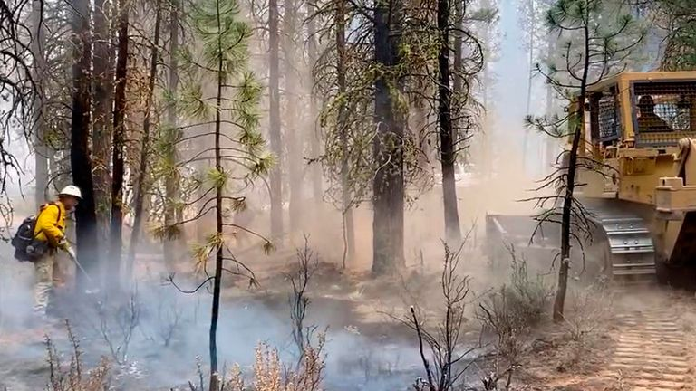 Firefighters battle the Bootleg Fire in southern Oregon