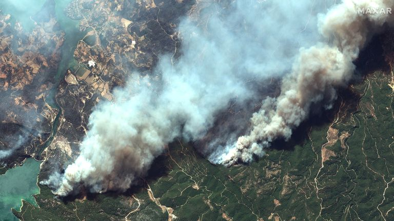 Plumes of smoke caused by the wildfires can be seen from the skies. Satellite image ©2021 Maxar Technologies