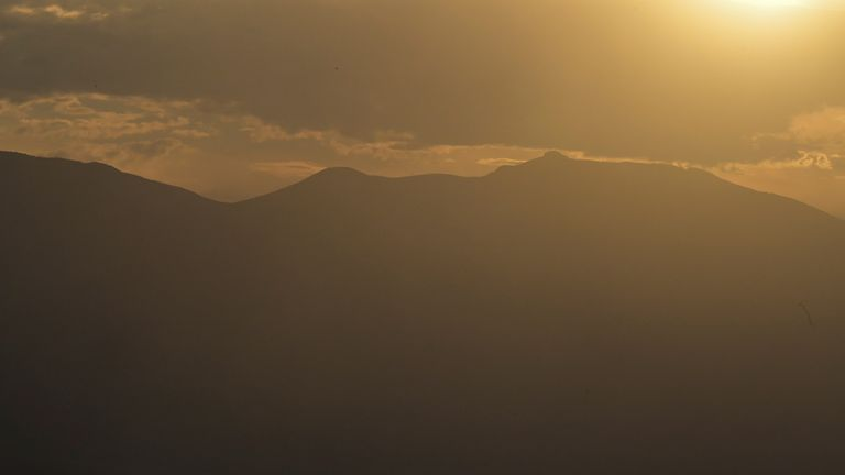 A dust storm is seen approaching as the sun sets in Death Valley, California