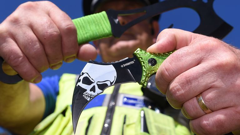 West Midlands PCSO Rob Capella holds two examples of 'zombie knives' at a secure police location in Birmingham in 2016