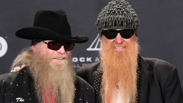 Dusty Hill (L) with bandmate Billy Gibbons as they were inducted into the Rock n' Roll Hall of Fame in 2012
