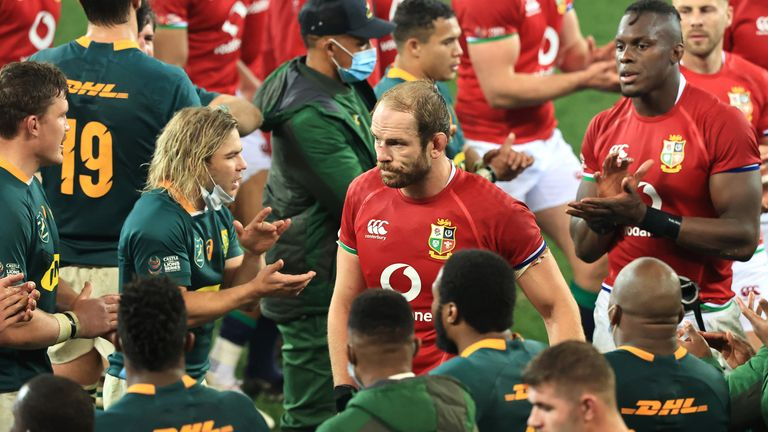 A dejected Alun Wyn Jones leads his beaten Lions team off the field at the conclusion of the second Test against South Africa