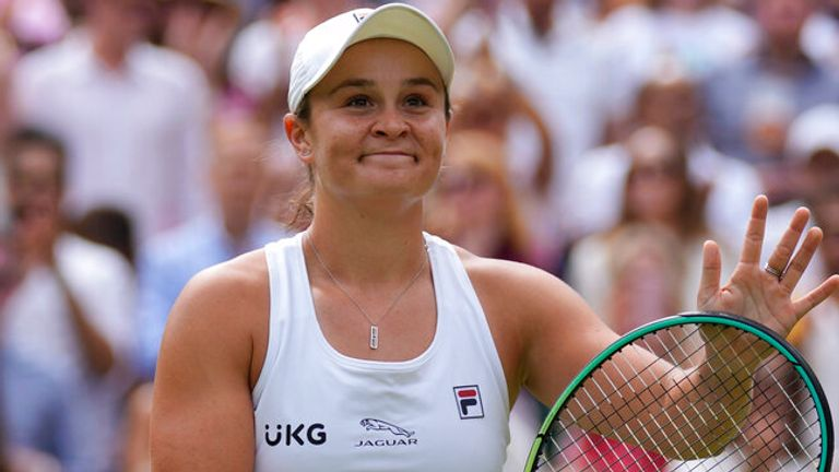 Australia's Ashleigh Barty celebrates after defeating Germany's Angelique Kerber during the women's singles semifinals match on day ten of the Wimbledon Tennis Championships in London, Thursday, July 8, 2021. (AP Photo/Kirsty Wigglesworth)