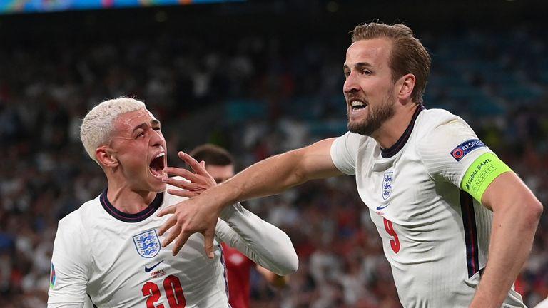 Harry Kane celebrates scoring with Phil Foden