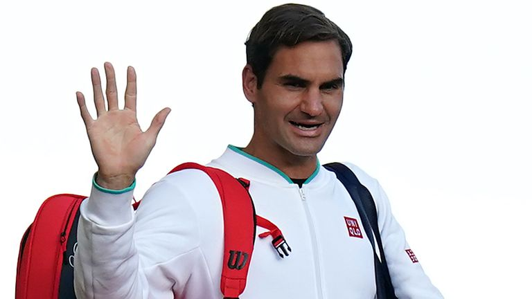 Roger Federer waves to the spectators as he walks over the bridge on day nine of Wimbledon at The All England Lawn Tennis and Croquet Club, Wimbledon. Picture date: Wednesday July 7, 2021.