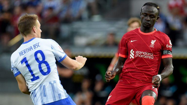 Sadio Mane of Liverpool competing with Santiago Ascacibar of Hertha BSC