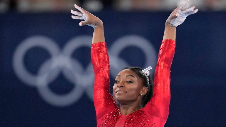 Simone Biles, of the United States, performs on the vault during the artistic gymnastics women's final at the 2020 Summer Olympics, Tuesday, July 27, 2021, in Tokyo. (AP Photo/Gregory Bull)
