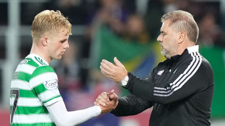 Celtic's Stephen Welsh is consoled by Ange Postecoglou