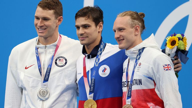 USA's Ryan Murphy, Russian Evgeny Rylov and GB's Luke Greenbank stand on the podium after the 200m backstroke final