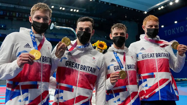 Tom Dean, James Guy, Matthew Richards, Duncan Scott pose after winning the 4x200m freestyle relay final at the 2020 Olympics