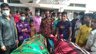 People gather around bodies of victims after lightning killed more than a dozen people in Shibganj in Chapainawabganj district. Pic: AP
