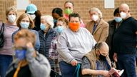 People are pictured queuing to get vaccines in Dallas amid high COVID rates. Pic: AP