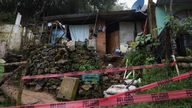 Red tape blocks the access to a house where several people were killed in a mudslide after Hurricane Grace pummeled Mexico with torrential rain on Saturday, in Xalapa, Mexico August 21, 2021. REUTERS/Yahir Ceballos