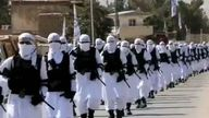 Taliban fighters march through Kandahar in uniform on Afghanistan's independence day