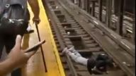 A stricken passenger lays prone on the tracks at the subway station in the Bronx, New York