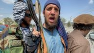 Taliban forces patrol near the entrance gate of Hamid Karzai International Airport, a day after U.S troops withdrawal, in Kabul
