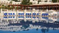 A tourist is seen near a pool in the Mediterranean Sea resort near Bodrum, Turkey. File pic