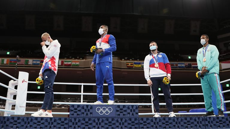 Tokyo 2020 Olympics -   Boxing - Men's Light Heavyweight - Medal Ceremony - Kokugikan Arena - Tokyo, Japan - August 4, 2021 - Gold medallist Arlen Lopez Cardona of Cuba , Silver medallist Benjamin Whittaker of Britain,  Bronze medallists Loren Berto Alfonso Dominguez of Azerbaijan and Imam Khataev of the Russian Olympic Committee stand during the medal ceremony. Pool via REUTERS/Buda Mendes