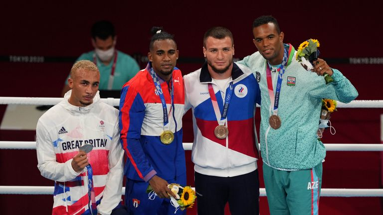 Aug 4, 2021; Tokyo, Japan;  From left, Benjamin Whittaker (GBR)  , Arlen Lopez (CUB) , Imam Khataev (ROC) and Loren Berto Alfonso Dominguez (AZE) after the men's light heavy 75-81kg final bout during the Tokyo 2020 Olympic Summer Games at Kokugikan Arena. Mandatory Credit: Kareem Elgazzar-USA TODAY Sports