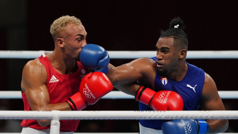 Aug 4, 2021; Tokyo, Japan;  Benjamin Whittaker (GBR) competes against Arlen Lopez (CUB) in the men's light heavy 75-81kg final bout during the Tokyo 2020 Olympic Summer Games at Kokugikan Arena. Mandatory Credit: Kareem Elgazzar-USA TODAY Sports