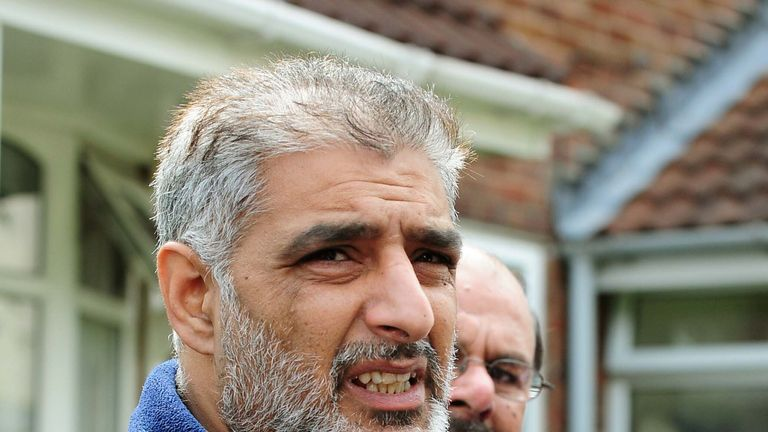 Tariq Jahan holds a picture of his son Haroon Jahan who died after being knocked down by a car in Dudley Street, Winson Green, Birmingham. PRESS ASSOCIATION Photo. Picture date: Wednesday August 10, 2011. Mr Jahan, told reporters how he tried to revive his son after he was knocked down. Three men were mowed down by a car and killed while protecting their community from looters, it was claimed. See PA story POLICE Shooting Birmingham. Photo credit should read: Rui Vieira/PA Wire