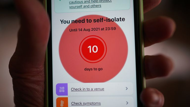 A message to self-isolate, with ten days of required self-isolation remaining, is displayed on the NHS coronavirus contact tracing app on a mobile phone, in London. Picture date: Tuesday August 3, 2021.