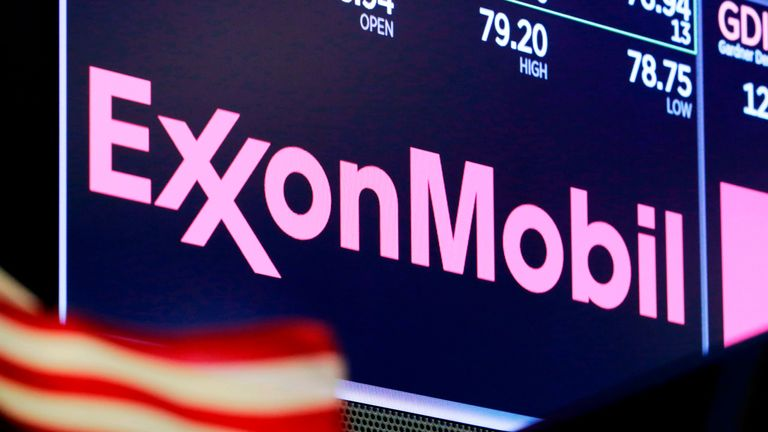 FILE - In this April 23, 2018, file photo, the logo for ExxonMobil appears above a trading post on the floor of the New York Stock Exchange. Exxon Mobil on Tuesday, March 3, 2020, outlined how it is reducing the methane its operations release into the atmosphere, detailing its efforts as governments around the globe write new rules to regulate the harmful greenhouse gas. (AP Photo/Richard Drew, File)