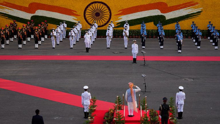Indian Prime Minister Narendra Modi inspects a joint military guard of honor during Independence Day celebrations from the ramparts of the historic 17th century Red Fort in New Delhi, India, Sunday, Aug. 15, 2021. India commemorates its 1947 independence from British colonial rule on Aug. 15. (AP Photo/Manish Swarup)